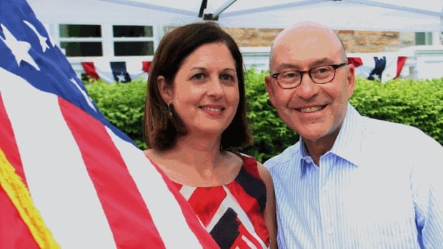 Outgoing U.S. Ambassador to Canada David Jacobson poses for photographers with his wife as they host the 4th of July celebrations at the U.S. ambassador's residence in Ottawa on July 4, 2013 in Ottawa. Bruce Heyman, a Goldman Sachs executive, is likely to take Jacobson's place.