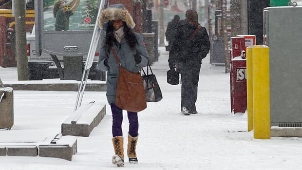 A woman braves cold weather as an Arctic air mass brings cold temperatures and wind chill to Toronto on Tuesday.
