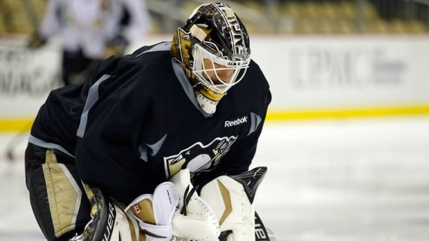 Pittsburgh Penguins goaltender Tomas Vokoun waits for a shot during practice on Sunday.