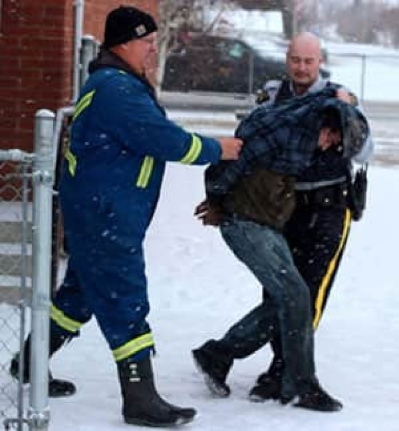 Sheridan Schools Closed Thursday As Manhunt For Suspects: St. Paul RCMP Lead A Suspect From The Crash Scene Thursday