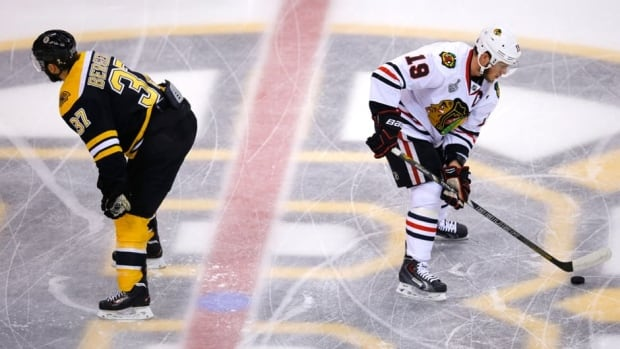 Boston Bruins' Patrice Bergeron, left, and Chicago Blackhawks' Jonathan Toews were both question marks ahead of Game 6 of the Stanley Cup final due to apparent injuries.