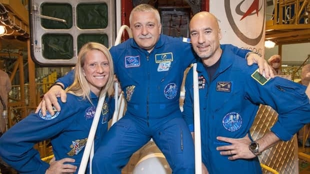 Flight Engineer Karen Nyberg of NASA, Fyodor Yurchikhin of Russia's Federal Space Agency and Flight Engineer Luca Parmitano of the European Space Agency pose for pictures in front of their Soyuz TMA-09M spacecraft May 24.