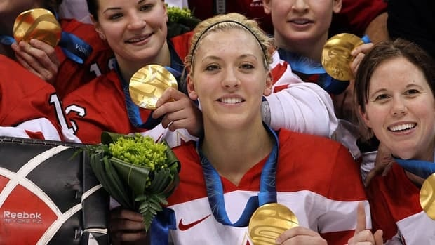 Meghan Agosta, centre, helped Canada win its second consecutive Olympic gold medal in 2010 in Vancouver.