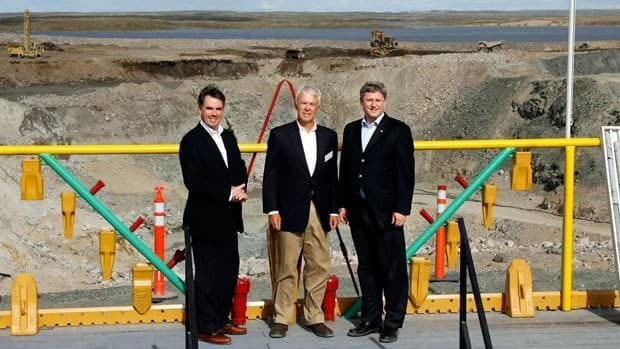 Prime Minister Stephen Harper, right, poses with then-Indian and Northern Affairs Minister Jim Prentice, left, and Tahera Diamond CEO Peter Gillin, in front of the mining pit before the official opening of the Jericho Diamond Mine project on Thursday, August 17, 2006, in Nunavut. Shear Diamonds bought the mine in 2010 after Tahera went bankrupt.)
