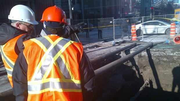 Work crews say a 128-year-old brick sewer pipe collapsed in downtown Montreal. (CBC)