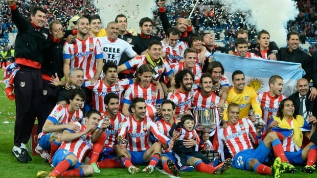 Atletico Madrid players celebrate after winning the Copa del Rey against Real Madrid on May 18, 2013.