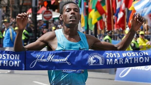 Lelisa Desisa of Ethiopia crosses the finish line to win the men's division of the 2013 Boston Marathon.