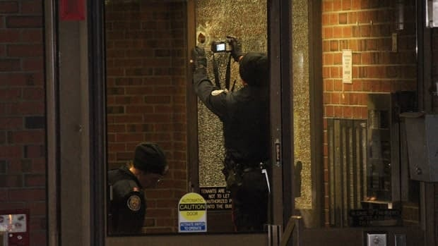 Police are seen investigating in the aftermath of a deadly shooting that claimed the life of Nisan Nirmalendran at a seniors' apartment building on Bleecker Street on the evening of Mar. 21, 2013.