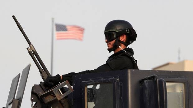A soldier guards the U.S. embassy in Manama, Bahrain Sunday, one of 21 U.S. embassies and consulates closed around the Middle East in response to an apparent al-Qaeda threat.