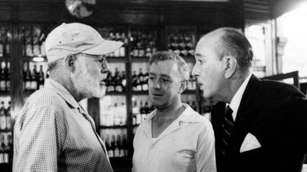 American novelist Ernest Hemingway, left, is shown May 12, 1959 in Sloppy Joe's Bar in Havana, Cuba. He is talking to actors Alec Guinness, centre, and Noel Coward during filming of Our Man in Havana, based on Graham Greene's novel.