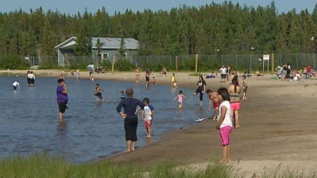 The N.W.T. government is considering limits on how many people can use the beach at Long Lake. (CBC)