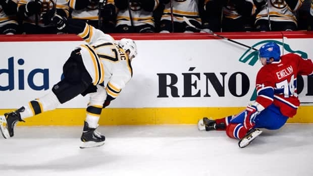 Alexei Emelin suffers the fateful injury resulting from the collision with Boston forward Milan Lucic in Saturday's win for Montreal.