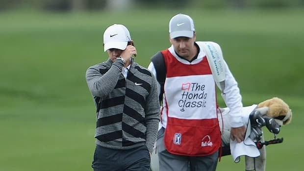 Rory McIlroy of Northern Ireland walks off the course with caddie J.P Fitzgerald during the second round of the Honda Classic early Friday in Palm Beach Gardens, Fla.