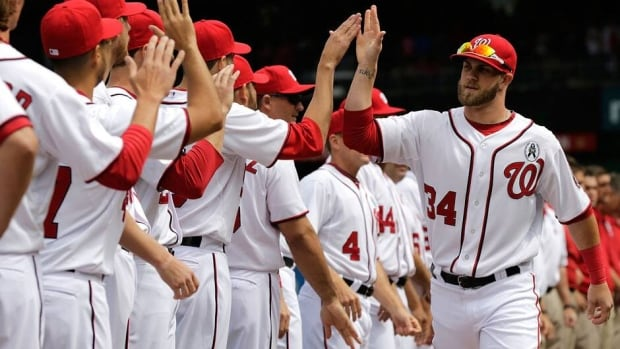 Bryce Harper, right, smacked a pair of homers on Opening Day to help Washington get off to a 6-2 start.