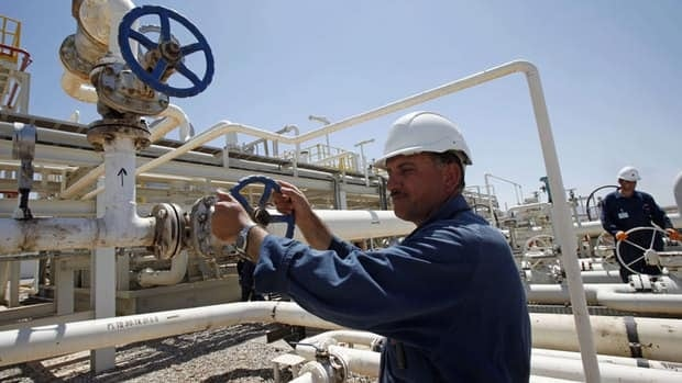 In this 2009 file photo, an employee works at the Tawke oil fields in the semiautonomous Kurdish region in northern Iraq.