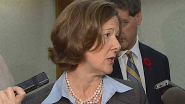 Alberta Premier Alison Redford speaks to reporters in Calgary on Friday.
