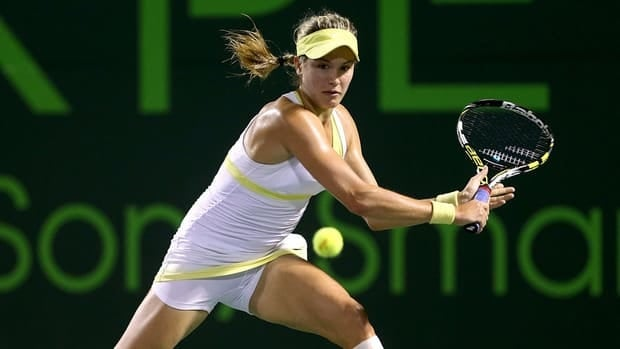 Eugenie Bouchard of Canada returns a shot to Maria Sharapova of Russia during the Sony Open on March 22, 2013 in Key Biscayne, Florida.