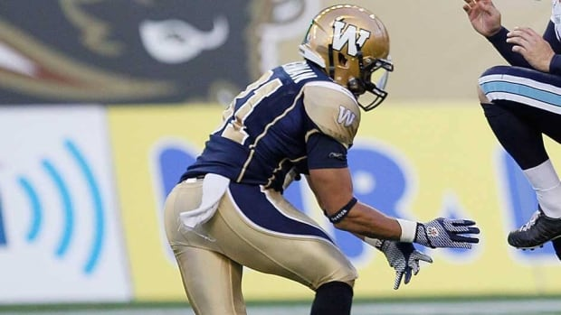 Winnipeg Blue Bombers' Teague Sherman blocking an opponent below the waist on a kickoff return on Friday night.