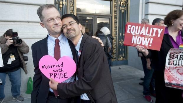 "John Lewis, left, and Stuart Gaffney embrace outside San Francisco's City Hall on June 26. Gaffney told CBC News, 'We are ecstatic to get another landmark ruling from the Supreme Court... advancing the rights of LGBT Americans towards full citizenship."" The couple are both activists with Marriage Equality USA."