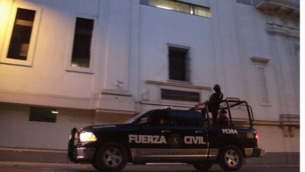 Police patrol outside the main office of the newspaper El Norte in Monterrey July 10. Gunmen shot and launched two grenades against two subsidiaries of the newspaper, with one exploding after it landed inside an office but no one was injured, according to local media.