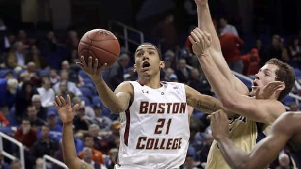 Olivier Hanlan, left, drives against Georgia Tech's Daniel Miller, during his team's 84-64 win at the Atlantic Coast Conference tournament in Greensboro, N.C.