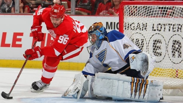Red Wings forward Tomas Holmstrom (96) tests Jaroslav Halak in a 3-1 triumph over the Blues at Joe Louis Arena on Jan. 23.