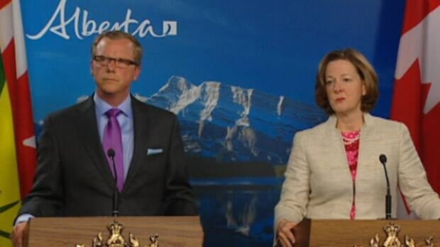 Saskatchewan Premier Brad Wall and Alberta Premier Alison Redford speak to reporters after meeting in Edmonton on Wednesday.