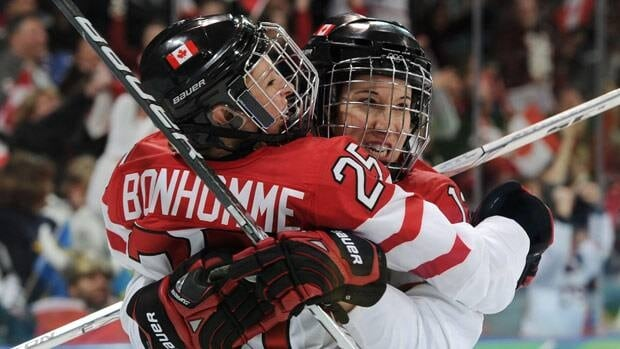 Caroline Ouellette, right, has been a part of many Canadian triumphs, including at the 2010 Winter Olympics with teammate Tessa Bonhomme.