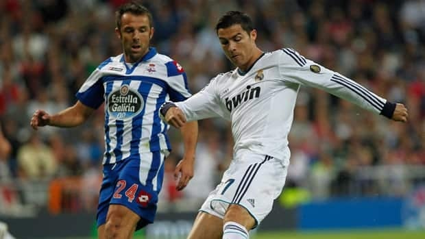Deportivo la Coruna's Carlos Marchena, left, battles with Madrid's Cristiano Ronaldo in a match earlier this season.