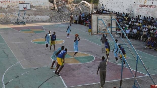 Sports like basketball, being played at Mogadishu's Lugino Stadium, have resumed in war-torn Somalia after a 20-year absence.