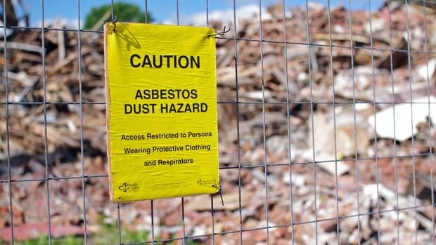 Workers are taking precautions to stop asbestos particles from becoming airborne during the demolition of the Empire Hotel in Thunder Bay.