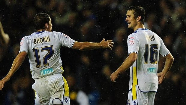 Leeds player Michael Brown celebrates with Danny Pugh, right, after the club's second goal in the Capital One Cup Third Round match at Elland Road in Leeds on Tuesday.
