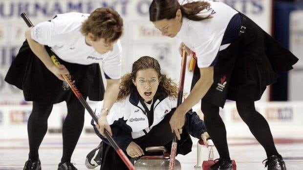 Colleen Jones follows a rock as teammates Kim Kelly (left) and Mary-Anne Arsenault sweep during Tournament of Hearts action in 2006. The trio will reunite, along with lead Jenn Baxter, for a run at the 2014 Olympic Games.