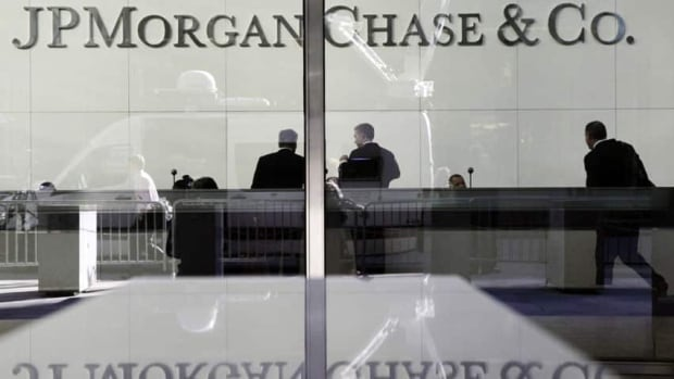 People stand in the lobby of JPMorgan Chase headquarters in New York. Two JPMorgan employees have been accused of covering up spiralling losses in the 'London Whale' case.