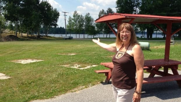 Sue St-Pierre owns Chez St-Pierre general store in Lavigne. Here, she points at the spot next to her store where the search and rescue helicopter reunited Alexie Levac with her family.