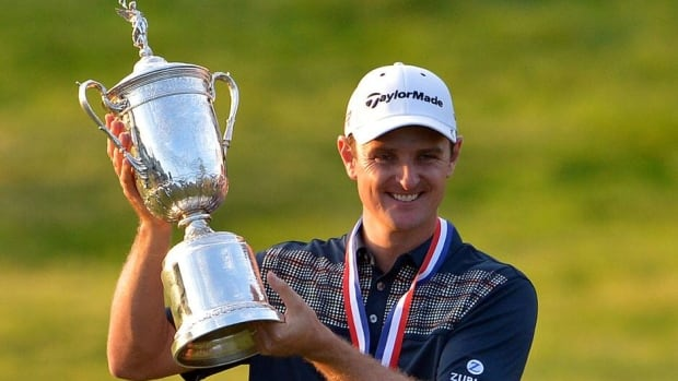 Justin Rose of England celebrates with the trophy after winning the 113th U.S. Open at Merion Golf Club on Sunday in Ardmore, Pa.