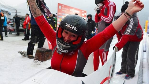 Canada's winner Kaillie Humphries reacts in front of Chelsea Valois in the finish area after the two-women bob race at the World Cup race Friday in Koenigssee, Germany.