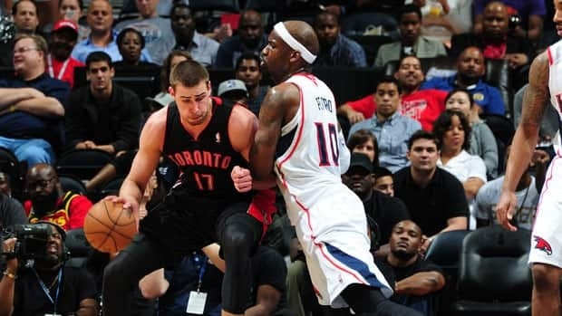Jonas Valanciunas of the Toronto Raptors, left, was named Eastern Conference player of the month for March.
