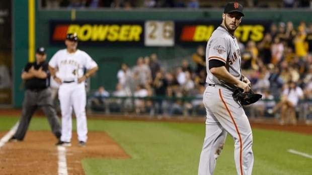 San Francisco Giants relief pitcher George Kontos, right, looks back towards home plate after being ejected for hitting Pittsburgh Pirates' Andrew McCutchen in the eighth inning Tuesday.
