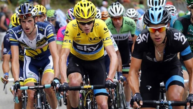 Christopher Froome, centre, and Richie Porte, right, ride during the 18 stage of the Tour de France on July 18, 2013.