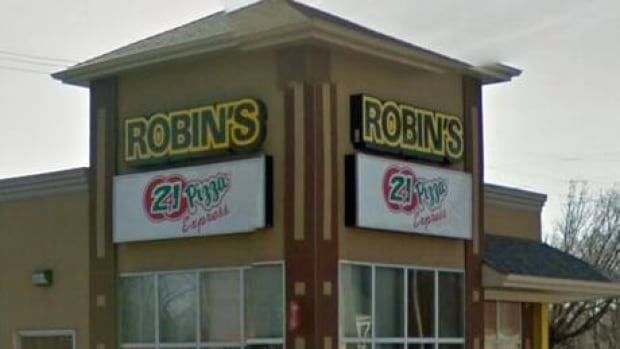 Police say a man brandishing a knife robbed a Robin's Donuts store early Thursday morning.
