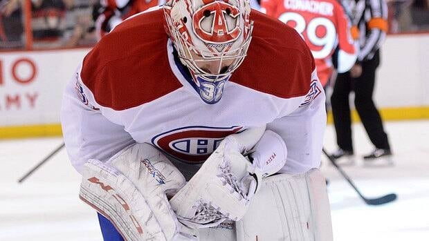 Canadiens goalie Carey Price skates away from the net keeled over after Senators forward Cory Conacher tied Tuesday's Game 4 with 23 seconds left in regulation. Ottawa scored in overtime to take a three games to one lead in the first-round playoff series.