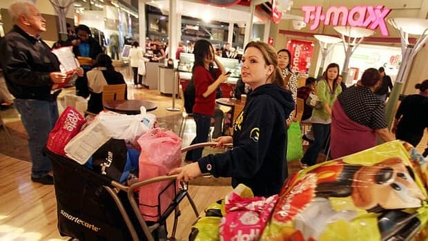 Laura Jarvi, of Windsor, Ont., looked for sales as she and other friends had their shopping carts full of purchases at Great Lakes Crossing Outlets in Auburn Hills, Mich., back in 2010. Canadian retail observers expected that cross-border shopping to the U.S. would increase in June once duty-free limits were increased for Canadians returning home.