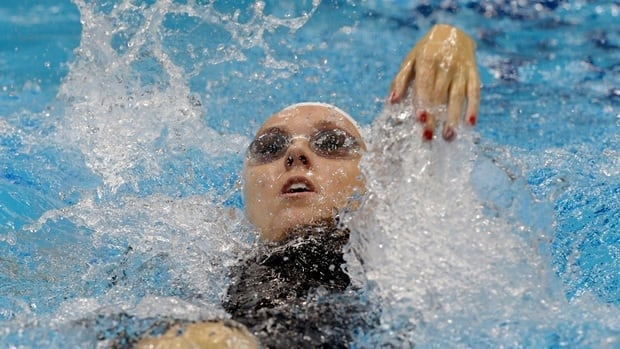 Canada's Summer Mortimer competes in a women's 100 backstroke S10 heat on Tuesday, in London. The Hamilton native set a world-record time on the way to gold in the event.