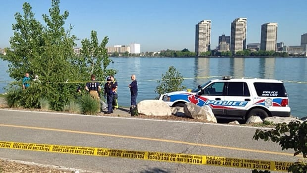 Windsor police are trying to identify a body that was found in the Detroit River on Sunday morning.