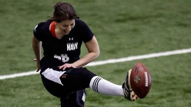 Lauren Silberman boots the ball during kicker tryouts at the NFL combine workout Sunday, in Florham Park, N.J.