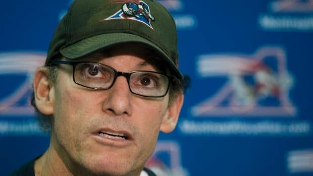 In this file photo Nov. 14, 2011, Montreal Alouettes' head coach Marc Trestman speaks to reporters in Montreal as his team clears out their lockers after being eliminated from the playoffs by the Hamilton Tiger-Cats.
