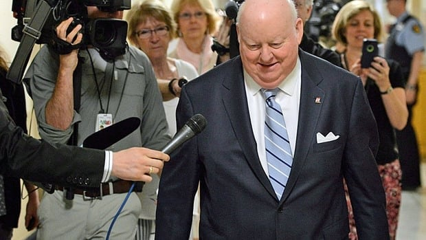 Senator Mike Duffy leaves a meeting of the Senate Internal Economy, Budgets and Administration committee on Parliament Hill Thurday May 9, 2013 in Ottawa.