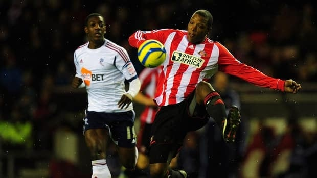 Bolton's Marvin Sordell, left, is beaten to the ball by Sunderland's Titus Bramble at Stadium of Light on January 15, 2013 in Sunderland, England.
