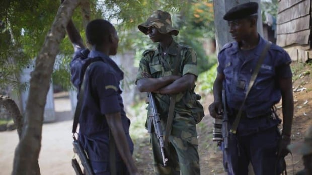 M23 rebels and police stand guard in Rutshuru, a community under their control in eastern Congo. Doctors Without Borders says Congo's army now controls only the city of Goma and the nearby village of Kibumba 10 kilometers, while rebels hold all towns as far north as Rutshuru.
